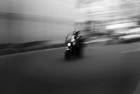 Blurred motorbike speeding on road