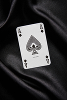 Single ace of spades on black background