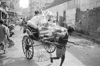 Man pulling rickshaw in street. Calcutta, India