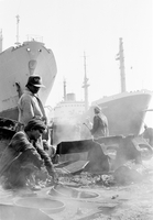 Workers in ship breakers yard. Alang ship breakers, Gujarat, India