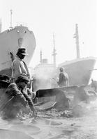 Workers in ship breakers yard. Alang ship breakers, Gujarat, India