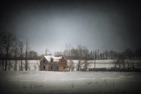 Abandoned farmhouse in a winter landscape