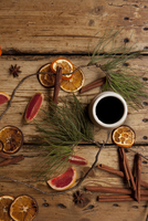Mulled wine on table with fruit and spices lying on wooden table. London, England, United Kingdom