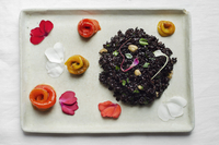 Vegan black rice with toasted hazelnuts, parsley, lemon and slow-roasted bell peppers