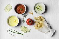 Baked celeriac fries with vegan mayo, tzaziki and roasted tomato basil dip