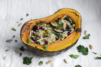 Vegan pomegranate and eggplant quinoa salad stuffed pumpkin
