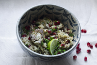 Vegan artichoke, toasted almonds, pomegranate, lemon and coriander quinoa salad