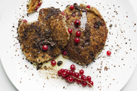 Vegan chocolate and red currant pancakes