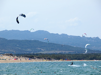 People kite surfing at Porto Puddu, Sardinia, Italy