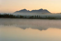 Mist rising off the Kobuk River at dawn infront of the The J