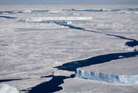 Leads snake between tabular icebergs as the Antarctic Summer