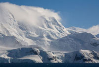 Cloud topped Mountain and katabatic winds blow over the lowe