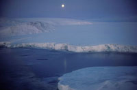 Edge of a tidewater glacier at freeze-up by moonlight in the