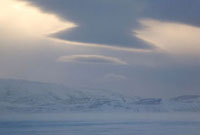 Lenticular cloud over Tkachen Bay on a stormy winter day. Ch