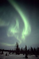 The Northern Lights (Aurora borealis) lights up the sky over
