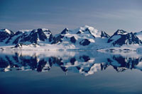 Mountains and Glaciers in the summer months reflected in an