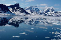 Mountains reflected in ice free sea during the short arctic