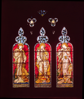 Three Trumpeting Angels, south aisle window, made by Morris,