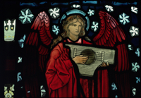 Detail of the Angel Musician, made by William Morris and Co.
