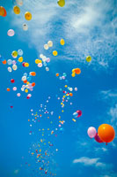 Colorful balloons float in the air