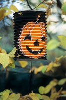 Paper lantern with pumpkin face print