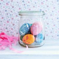 Coloured eggs in jar