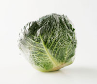 Savoy cabbage packed in plastic film