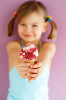 girl holding Amarena cherry ice cream