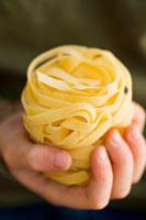 Pasta nest in childs hand