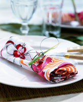 A place setting with printed napkin