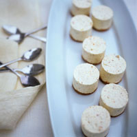 Vanilla cream cheesecakes on biscuits