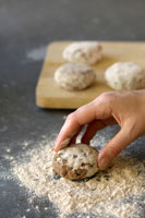 Coating meat patties in wholemeal flour