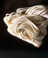 Udon noodles on black background