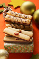 Nut fingers with chocolate and pine nuts