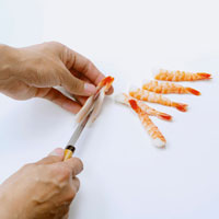 Making nigiri sushi with shrimps