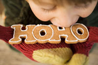 Child biting into gingerbread