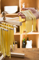 Hanging home-made ribbon pasta up to dry