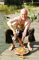 Woman sitting seasoning couscous salad