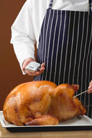 Chef checking roast turkey
