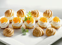 Profiteroles filled with soft cheese