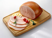 Cooked ham, partly sliced