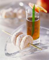 Marzipan cookies threaded on skewer
