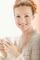 Red-headed woman holding a teacup