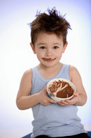 Boy holding bowl of chocolate pudding