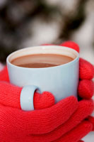 Hands holding a cup of hot chocolate