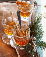 Tea with rum with sugar swizzle sticks