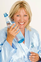 Woman holding a bottle of mineral water