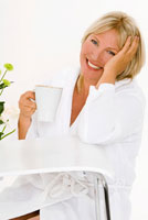 Woman sitting with a cup of cappuccino