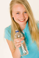 Girl holding a bottle of mineral water