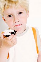 Boy with a marshmallow wafer